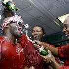 Torii Hunter, Howie Kendrick and Chone Figgins were feeling bubbly after sweeping the Red Sox out of the ALDS on Oct. 11.