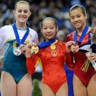 The controversial Olympic gold medalist -- now a grizzled veteran -- poses with her haul at the Artistic Gymnastics World Championships. That's Australia's Lauren Mitchell on the left and Ivan Hong of the U.S. on the right.