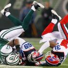 Braylon Edwards of the Jets and Ashlee Palmer (59) and Jairus Byrd (31) of the Bills bust out some spontaneous breakdancing during Buffalo's 16-13 OT triumph on Oct. 18.