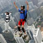 Talk about falling in love. An unidentified couple took the express route down from the 1,381 foot KL Tower in Kuala Lumpur, Malaysia on October 24. Hope someone remembered the parachutes...