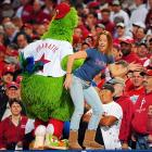 A certain mascot continues to keep fair maidens on their guard, in this instance at Game 5 of the NLCS at Citizens Bank Park in Philadelphia on Oct. 21.