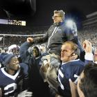 Paterno is carried off the field after recording his 409th career win, the most in NCAA Div. 1 football history.