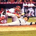 Hideki Matsui scores past Jeff Mathis on a triple in the seventh inning of Game 5 of the ALCS.