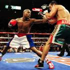 """After a 21-month retirement, Mayweather returned to face Marquez, at a catch-weight of 144 pounds. The time off hardly seemed to affect the 32-year-old Mayweather, who pummeled Marquez -- """"Money"""" landed 59 percent of his punches for a unanimous-decision victory, while Marquez only landed 12 percent."""