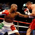 """In the largest pay-per-view fight in history (2.45 million buys), Mayweather moved up to 154 pounds to face six-division champion and WBC super welterweight titlist De La Hoya. The title fight was supposed to """"save boxing,"""" but controversy arose as Mayweather earned a split-decision victory when many saw the fight in De La Hoya's favor."""