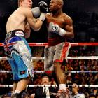 """Mayweather put his WBC welterweight title and flawless record on the line as he took on then-undefeated Ricky Hatton in Las Vegas. Hatton, the light welterweight champion, managed to give Mayweather a challenge early on, and even Floyd admitted Hatton was """"one of the toughest competitors I've faced."""" Still, Mayweather peppered the British brawler with punches until the referee stopped the fight in the 10th round."""