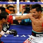 """Their first meeting, a split-decision win in Pacquiao's favor, ended on a sour note, thanks to a judging mistake -- one judge who had it 113-113 admitted making an error on the scorecard. Their rematch, aptly named """"Unfinished Business,"""" also ended with a disputed split-decision victory for Pacquiao, who earned his third world title in three divisions. He turned down a third match so he could move to lightweight."""