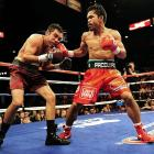 """Pacquiao's eighth-round TKO over the """"Golden Boy"""" put the petite puncher on the map. Though he had already claimed five world championships and was recognized as the leading pound-for-pound fighter since Mayweather's retirement, Pac-Man wasn't favored by all against De La Hoya. Many believed the 147-pound weight limit to be too high for Pacquiao. But he defied all critics when De La Hoya's corner threw in the towel before the start of the ninth round."""