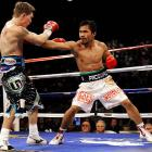 """After a dispute over the fight purse, Pacquiao and Hatton finally agreed to terms for """"The Battle of the East and West."""" The battle was short-lived as Pacquiao knocked out Hatton in the second round to win the IBO and Ring Magazine light welterweight titles."""