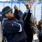 Alex Rodriguez prepares to field a soft roller at the Yankees' World Series victory parade in Lower Manhattan on Nov. 6.
