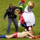 His baseball team doomed, the Phillie Phanatic took out his frustrations on a Yankees partisan while a clearly horrified Smokin' Joe looked on during Game 4 of the World Series at Citizens Bank Park in Philadelphia on Nov. 1.