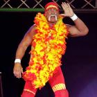 The Hulkster sports the latest in cutting edge evening wear as he enters the ring to exchange pleasantries with Ric Flair during the Hulkamania Tour at Burswood Dome in Perth, Australia.