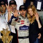 Finishing fifth meant a fourth Cup as Jimmie Johnson tries to demonstrate with help from his lovely spouse and a pair of giddy admirers after bagging his latest NASCAR championship, at Homestead-Miami Speedway.