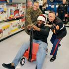 It appears that armed forces personnel had to be called in to evict a St. Nick impersonator who crashed the Shaq-A-Claus event in Mayfield, Ohio.