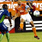 While he was across the country resting up for a World Cup game, the Dynamo player was fined $500 by MLS for this tweet:   ''Ref in seattle just cheated the dynamo. What a joke. Not even close. Ref is a cheat''