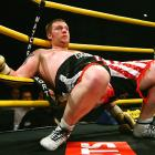 "Danny Hughes, a 23-year-old boxer from Sunderland, England, reclined pensively after being knocked down by Audley Harrison on Oct. 2 in the semifinals of Prizefighter Heavyweights III, an eight-man tournament for British boxers held in the East End of London.<br><br>""What I like about the picture is that the guy has been clean knocked [down], and if it had not been for the ropes, he would have been knocked into the judges below."" -- Photographer Jamie McDonald/Getty Images"