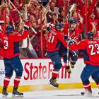 "Capitals left wing Alex Ovechkin (center) celebrated a hat trick with teammates Sergei Fedorov and Milan Jurcina on May 4 during Game 2 of Washington's second-round series against the Penguins in D.C. Pittsburgh won the series in seven games and went on to claim the Stanley Cup.<br><br>""Ovechkin is dynamic and explosive. Add the intensity of a playoff game and a hat trick to boot, and those ingredients combine to make an image reflective of his passion for the game. He's fun to watch, and a joy and challenge to photograph."" -- Photographer Lou Capozzola/SI"