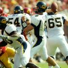 USC's 2004 national title run almost came to an end because Cal quarterback Rodgers simply couldn't miss. He completed his first 23 pass attempts, breaking the NCAA single-game record and falling three short of former Tennessee quarterback Tee Martin's consecutive completion record set over two games. Unfortunately, Rodgers cooled at the worst possible time -- with an assist from the USC defense. He had completed 29-of-31 passes when the Bears lined up for first-and-goal from the USC nine-yard line with less than two minutes remaining. In the next four plays, he was sacked once, and threw three incompletions. Cal fell 23-17 but Rodgers' accuracy against one of the nation's best defenses turned him into a Heisman Trophy candidate.