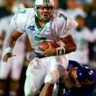 """Several thousand fans left at halftime, when Marshall trailed East Carolina by 30. Leftwich would make those fans regret their haste. The Marshall quarterback led the Thundering Herd to a 64-61, double-overtime victory in the highest-scoring bowl ever. Leftwich completed 41-of-70 passes for 576 yards and four touchdowns. He also ran for a score. """"Lord, have mercy,"""" East Carolina coach Steve Logan said. """"I hope everyone got their money's worth."""""""