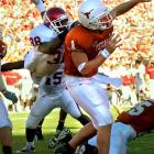 """Oklahoma defensive coordinator Mike Stoops told his star strong safety Williams not to jump. Williams didn't listen. With Texas backed up near its own goal line, a blitzing Williams launched himself over fullback Brett Robin and into quarterback Chris Simms, who tried to throw the ball away but ended up throwing directly to Oklahoma linebacker Teddy Lehman. Lehman danced two yards into the end zone. Williams intercepted Simms' next attempt -- the third consecutive Simms pass to be intercepted -- to cap the Sooners' 14-3 win. """"He's the best defensive player I've ever been around,"""" OU coach Bob Stoops said of Williams."""