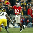 In one of the most meaningful meetings in one of college football's best rivalries, Ohio State's Smith put an exclamation point on his Heisman Trophy resume by tearing apart the second-ranked Wolverines for 316 yards and four touchdowns in a 42-39 victory.