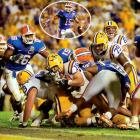 Tensions began before the Gators ever got to Baton Rouge. LSU fans found Florida quarterback Tim Tebow's cell-phone number and deluged him with mocking calls and text messages. Tebow wasn't intimidated by the stunt. After scoring a first-half touchdown, he ran toward the LSU student section and put his hand to his ear to mimic a phone call. Down 10 in the fourth quarter, the Tigers roared back behind battering ram Jacob Hester, who plowed through Florida defenders on two fourth-down plays to set up a two-yard touchdown run that capped LSU's eight-minute, 11-second, game-winning drive. A 28-24 win vaulted the Tigers to the top of the polls, and though they suffered two losses later that season, they still won the BCS title.
