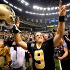 In a <i>Monday Night Football</i> showdown with Tom Brady and the Patriots, Brees completed 18-of-23 for 371 yards and five touchdowns (to five receivers) while racking up a perfect passer rating as New Orleans improved to 11-0 with a 38-17 victory.