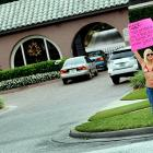 Standing strong outside the gate of Tiger Woods' toney Isleworth (Fla.) community, the MJ Radio personality offered her own special brand of support for the beleagured golf superstar.