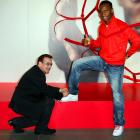 U2's lead warbler has a sparkling future as a shoe salesman. Here, he ties a pair of size 9's on Chelsea forward Drogba at Nike Town in London.
