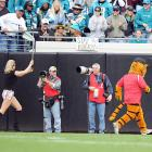 There's just no escaping the Tiger Woods saga these days, not even at a Houston Texans-Jacksonville Jaguars game. . .