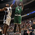 """The Celtics didn't leave Florida unscathed, however, as Kevin Garnett (5) was injured while attempting to block a shot by Vince Carter in the closing minutes. Though Garnett didn't return, coach Doc Rivers didn't seem too worried about the big man's reported bruise on his head. """"If he grew some hair,"""" said Rivers, """"it wouldn't hurt so much."""""""