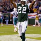 The Jets' defensive back was charged with firearms possession when a .223-caliber Bushmaster semiautomatic rifle and 200 rounds of ammo were found in the trunk of his car as he entered Giants Stadium in October 2001. He helped the Jets beat the Dolphins a few hours later and was arraigned afterward.