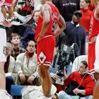"""As much as he was known for his presence on the boards, Rodman was known more for his presence in the headlines. And during a 1997 game at Minnesota, he lived up to his reputation by capping off a 15-rebound performance with what would result in an 11-game suspension. After tripping over baseline cameraman Eugene Amos, Rodman kicked him in the groin so hard that Amos had to be carried off on a stretcher. Afterward, Rodman, who lost an estimated $1 million in salary as a result of his suspension, scoffed at the severity of the incident, saying, """"Maybe I'll send him some roses on the floor."""""""
