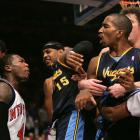 Carmelo Anthony received the harshest punishment -- a 15-game suspension and badly damaged image -- after the 2006 brawl between the Knicks and Nuggets, in which an altercation between Mardy Collins and Smith (right) escalated to include 10 players. But Knicks guard Nate Robinson (left) and Smith played no small roles in the incident as they spilled into the stands. They each received 10-game suspensions.
