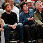 Mr. Duchovny's daughter Madelaine does not seem to approve of his eau de pastrami aftershave while they take in a scintillating Knicks game at Madison Square Garden on Feb. 9. Mr. Hoffmarn (right) was accompanied by his son Jacob.
