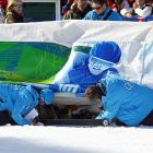 It appears the Chilean Alpine skier has crawled under the safety fence and is refusing to come out. Trained officials are obviously trying to coax her to return to the downhill competition. Stay tuned.