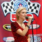 American Idol Katharine McPhee belts out the National Anthem at the Sprint Cup Series Auto Club 500, though looks slightly perplexed about why she's there.