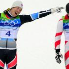 Runnerup Kjetil Jansrud tries to persuade gold medalist Carlo Janka that he's standing in the wrong spot for their giant slalom awards ceremony.