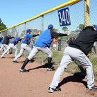 Showing off their, ahem, assets, the Mets stretch it out during spring training in Port St. Lucie, Fla.