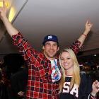 Nick Baumgartner threw up the devil horns with Jillian Samueli, daughter of Anaheim Ducks owner Henry Samueli, after the United States beat Canada in men's hockey.