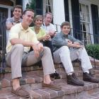 The Mannings strike a pose on their front steps.