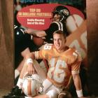 Peyton poses for an SI cover shoot with a background prop featuring the 1970 issue of his father on the cover.
