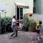 Cooper and Archie shoot hoops at the family's New Orleans home as Peyton looks on.