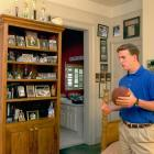 Peyton admires his pictures and trophies on display in the family home.