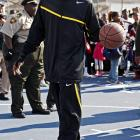 Bryant tries out the refurbished Stallings playground in New Orleans in 2008.