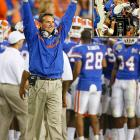 "Urban Meyer is stepping down as Florida coach -- this time for good. One year after resigning the post and then abruptly changing his mind, Meyer announced his intention to leave college coaching in order to focus on his family and non-football interests. ""Sometimes, we make it too complex,"" Meyer said in his Dec. 8 announcement. ""At the end of the day, I'm very convinced that you're going to be judged by how you are as a husband and as a father and not by how many bowl games you've won."" Meyer led the Gators to national championships in 2006 and '08, but went just 7-5 during a frustrating 2010 season."