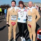 The enchanting Russian model (center) spent a little quality time with two obviously appreciative fans before the Naked Heart Foundation Paris Semi-Marathon -- which was obviously inspired by the Lower Sheboygan Fig Leaf 5k.