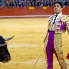 Looks like this fellow is about to get the point while striking a gallant pose at the Plaza Valencia bullring in Spain.on March 20.