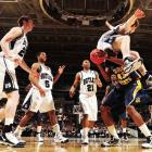 Butler forward Matt Howard lands on Murray State center Tony Easley during Butler's 54-52 win in the second round of the NCAA tournament in San Jose.