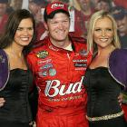 """Junior has a good time celebrating with the """"Crown Royal Girls"""" after winning the Crown Royal 400 in 2006."""
